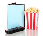 Popcorn with TV control panel and disk isolated on white — Stock Photo