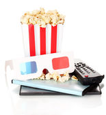 Popcorn with TV control panel and disks isolated on white — Stock Photo