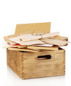 Wooden crate with papers and letters isolated on white — Stock Photo