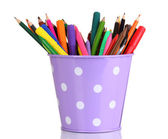 Colorful pencils and felt-tip pens in purple pail isolated on white — Stock Photo