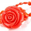 Beautiful peach-colored bracelet with rose isolated on white — Stock Photo #12570165