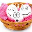 White eggs with funny faces in basket isolated on white - ストック写真