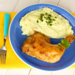 Roasted chicken leg with mashed potato in the plate on white wooden table c — Stock Photo #12575028