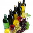 Stock Photo: Bottles and glasses of wine and ripe grapes isolated on white