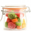 Colorful jelly candies in glass jar isolated on white — Stock Photo #12575451