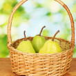 Ripe pears on colorful green background — Stock Photo #12575761