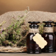 Thyme herb and mortar on wooden table on brown background - Foto Stock
