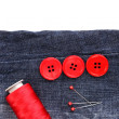 Stock Photo: Colorful sewing buttons with thread on jeans isolated on white
