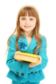 Cute little girl with a book isolated on white — Stock Photo