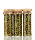 Glass jar with tinned capers isolated on white — Stock Photo