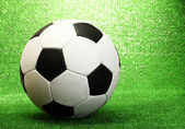 Football ball on artificial green grass — Stockfoto
