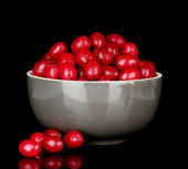 Fresh cornel berries in bowl isolated on white — Stock Photo
