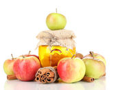 Honey and apples with cinnamon isolated on white — Stock Photo