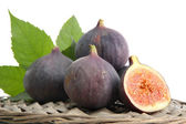 Ripe sweet figs with leaves isolated on white — Stock Photo