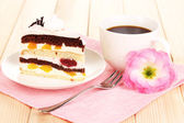 Layered fruit cake on wooden table — Stock Photo