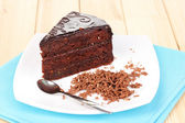 Chocolate sacher cake on wooden table — Foto de Stock