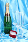 Wedding accessories on blue cloth background — Stock Photo