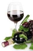 Bottle of wine with grape leaves isolated on white — Stock Photo