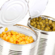 Stock Photo: Open tin cans of corn and peas isolated on white