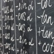 Math formulas written on the desk — Stock Photo #12645678