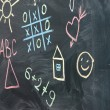 The drawings and inscriptions in colorful chalk on the blackboard — Stock Photo