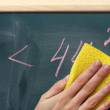 Stock Photo: Hand writing mathematical test on the blackboard