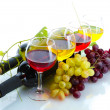 Bottles and glasses of wine and ripe grapes isolated on white — Stockfoto