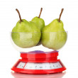 Ripe pears in kitchen scales isolated on white — Stock Photo #12646020