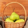 Ripe pears in sack on wooden background close-up — Stock Photo #12646024