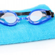 Swim goggles on towel isolated on white — Stock Photo
