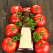 Stock Photo: Ketchup in bottle and tomatoes on wooden table