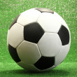 Stock Photo: Football ball on artificial green grass