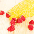 Tasty cheese and berries on wooden background — Photo