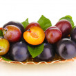 Stock Photo: Rip plums on basket isolated on white