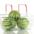 Ripe watermelon in metal basket isolated on white — Photo