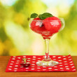 Watermelon ice cream in a glass on green background close-up — Photo