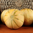 Sweet melon on wicker mat on sackcloth background close-up - Stock Photo
