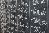 Math formulas written on the desk — Stock Photo