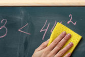 Hand writing mathematical test on the blackboard — Stock Photo