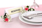Table setting with reserved card in restaurant — Stock Photo