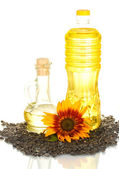 Sunflower oil in a plastic bottle and small decanter isolated on white back — Stock Photo
