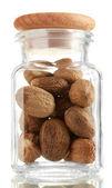 Jar with nutmeg isolated on white — Stock Photo