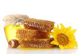 Sweet honeycombs, jar with honey, wooden drizzler and sunflower, isolated o — Stock Photo