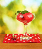 Watermelon ice cream in a glass on green background close-up — Stock Photo