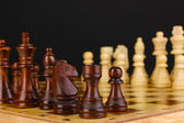 Chess board with chess pieces isolated on black — Stock Photo