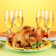 Banquet table with roasted chicken on orange background close-up. Thanksgiv - Stock Photo