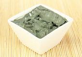 Cosmetic clay in white bowl close-up — Fotografia Stock