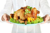 Chef holding a plate of baked chicken with fruit and spices close-up — Stock Photo