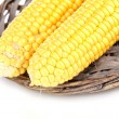 Stock Photo: Fresh corn cobs on wicker mat isolated on white