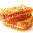 Sweet honeycombs with honey, isolated on white — Foto Stock